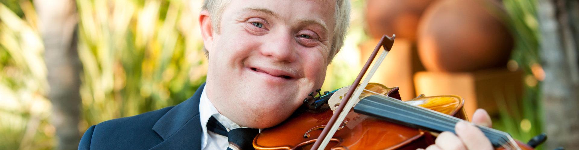 happy kid playing violin