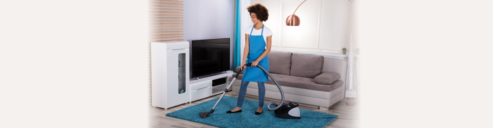 janitress cleaning carpet