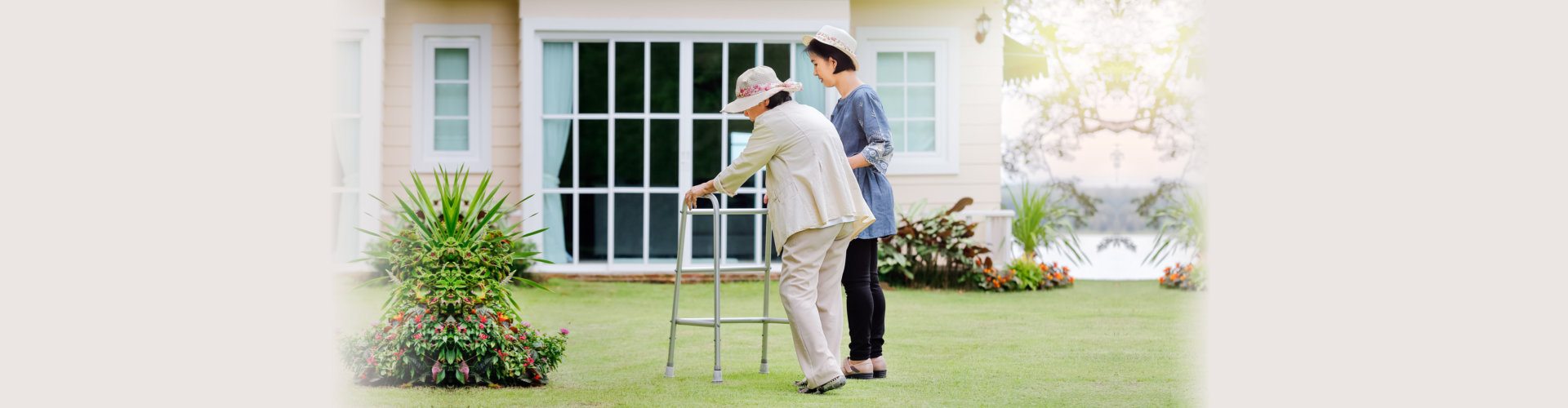 elderly woman exercise walking in backyard with caregiver