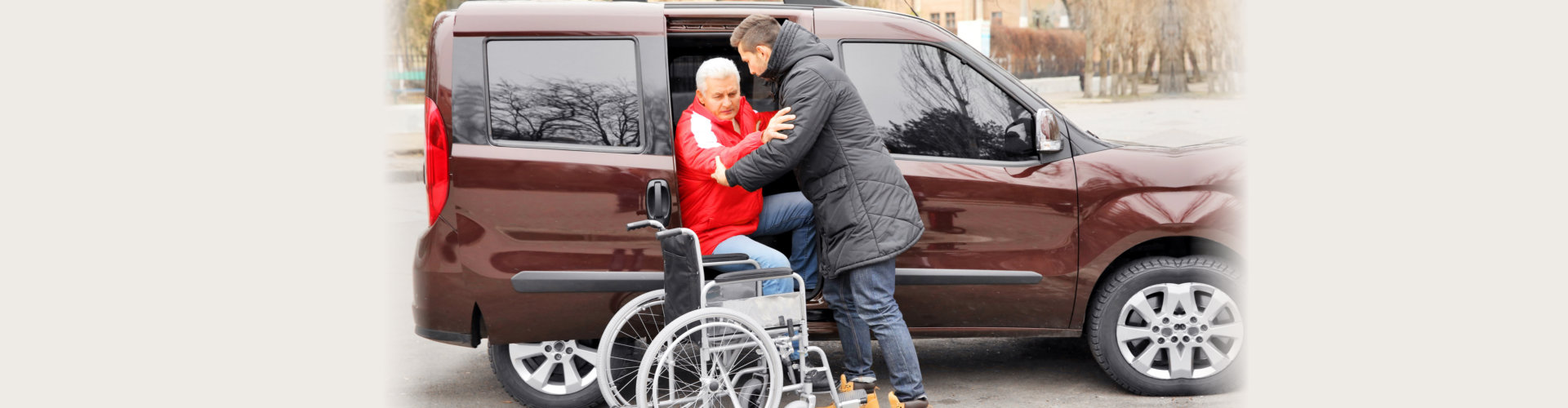 man helping handicapped man to sit in wheelchair